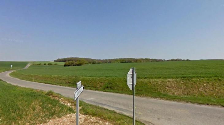The sunken road was known as Accroche Street, seen today looking northeast; the Germans advanced from the right (GoogleEarth).